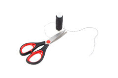 Balck thread and scissors on white background Royalty Free Stock Photos