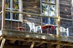 Balcón de madera de la casa Fotografía de archivo