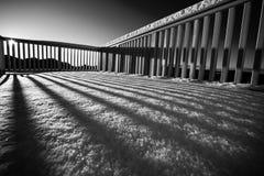 Balcone con neve ed ombre Fotografia Stock
