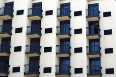 Balconies. Rows of balconies in a highrise building royalty free stock photography