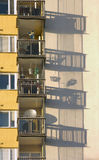 Balconies. On a block of flats casting a shadow on the wall Royalty Free Stock Image