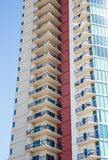 Balconies on Beige and Red Condo Tower Royalty Free Stock Image