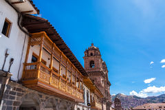 Balconies and Church in Cusco, Peru Royalty Free Stock Image