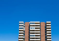 Balconies on Condos Under Clear Blue Sky Royalty Free Stock Photo