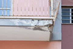 Balconies with cracked concrete requiring renovation Stock Photo