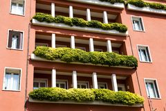 Balconies decorated by greenery. Building with balconies decorated by greenery Stock Image