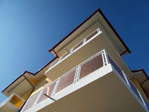 Balconies. A detail of a new block building with balconies on blue clean sky Stock Photos