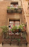 Balconies. Filled with plants overlooking the narrow streets of Cagliari on the island of Sardinia, Italy Royalty Free Stock Photography