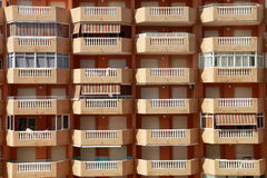 Balconies holiday apartment building. Building terraces, all the same but with different ornamentation Royalty Free Stock Photo