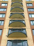 Balconies of a modern highrise condo. Urban housing. Balconies of a newly constructed highrise apartment building stock photos