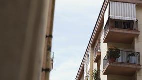 Balconies of modern living building at resort town street stock video footage
