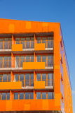 Balconies at a modern orange appartment building in Groningen Stock Images