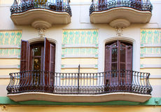 Balconies in old house in Barcelona Stock Photo