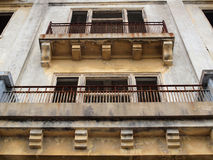 Balconies of a old worn building missing windows Stock Photography