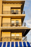 Balconies Over Blue Striped Awning stock photo