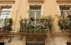 Balconies. Overlooking the narrow streets of the town of Cagliari on the island of Sardinia, Italy Stock Image