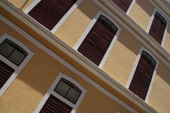Balconies pattern 2. Old building brown balconies pattern royalty free stock photo
