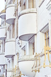 Balconies. Semi-circular balconies on a UK apartment building stock photo
