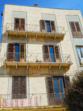 Balconies and shutters in provincial Italian house Stock Photo