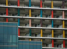 Balconies of the skyscraper with colored columns stock photos