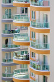 Balconies of tall buildings with glass railings Royalty Free Stock Image