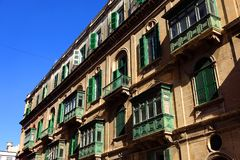 Balconies of Valletta, Malta. The green shuddered balconies found in the city of Valletta, Malta Stock Photo