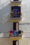 Balconies with Washing and Plant Pots Royalty Free Stock Photography