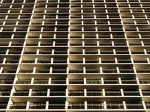 Balconies and Windows of Building looking upwards Stock Photo
