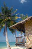 Balcony. View of  bamboo house on the sandy beach Royalty Free Stock Photography