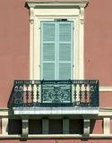 Balcony. A classic mediterranean balcony and shuttered doors Royalty Free Stock Photography