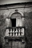 The balcony. Ancient balcony in abandoned mansion Stock Photos