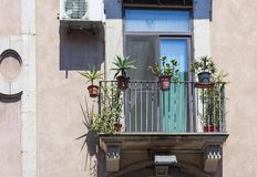Balcony of an ancient building in Catania, Sicily, Italy royalty free stock photography
