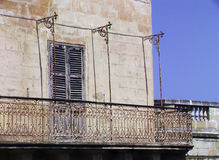 Balcony of an ancient house in mediterranean style with blue sky background Stock Photography