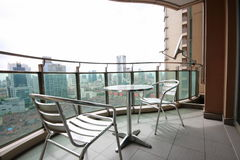 Balcony of an apartment. With chairs and table in Shanghai stock photography