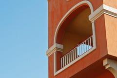 Balcony arch of arabic orange house background blue sky.  Stock Images
