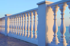 Balcony balusters with sea views. The view from the balcony of balusters of the sunset over the sea Stock Photography