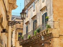 Balcony of a baroque palace in Lecce, Puglia. Typical balcony of a baroque palace in Lecce, Puglia, Italy stock photo