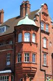 Balcony in a british red brick mansion. Detailed view of a balcony in a typical british red brick mansion Stock Photography