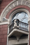 Balcony of the building is in classical style with decoration in the form of fish. Kiev Stock Image