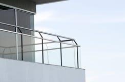 Balcony. Building balcony construction made of mirror glass and iron Stock Image