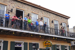 Balcony at Burbon Street French Quarter of New Orleans - NEW ORLEANS, LOUISIANA - APRIL 18, 2016 Stock Photo
