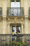 Balcony with carved statuary of apartment, Paris, France Royalty Free Stock Photos