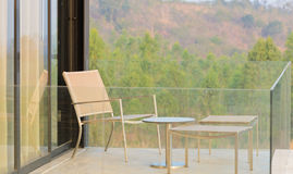 Balcony with chair and table Stock Photos