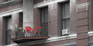 Balcony with chairs. Balcony with red chairs and windows royalty free stock photos