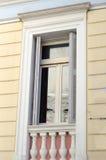 Balcony classic building. Balcony wooden windows shutters marble rails Stock Photo