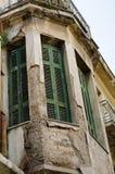 Balcony classic building. Balcony wooden windows shutters rusty rails Stock Photography