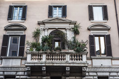 Balcony of a classical building in Rome, Italy. Balcony with plant pots of a classical building in the historical center of Rome, Italy Royalty Free Stock Image
