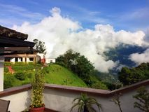 BALCONY IN THE CLOUDS 2, BANOS ECUADOR. Partial view of the grounds at Luna RunTun boutique hotel. It has spectacular, fairy tale like views of old Spanish Royalty Free Stock Image
