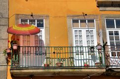 Balcony with a colorful umbrella Royalty Free Stock Photo
