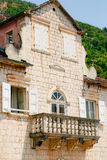 Balcony with columns in an old house. Balkan architecture. Monte Stock Image